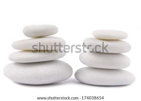 white stone pebble zen isolated on white - stock photo