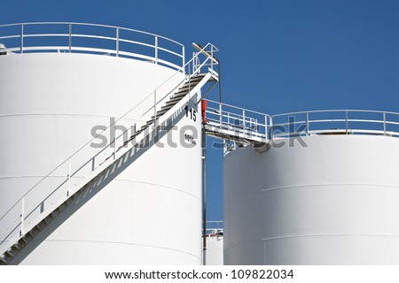 White storage tanks - stock photo