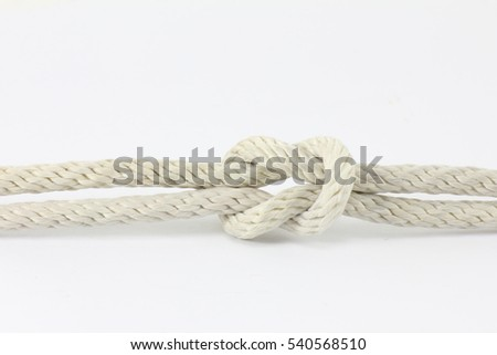 white string knotted on a white background.