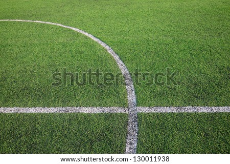 White stripe line on the artificial green grass field - stock photo