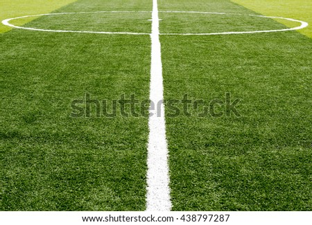White stripe on the artificial green grass soccer field from top view