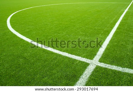 White stripe on the artificial green soccer field from top view - stock photo
