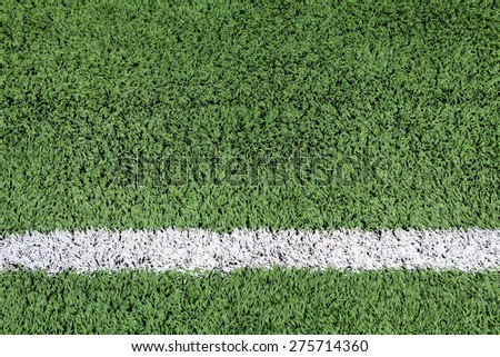 White stripe on the green football field - stock photo