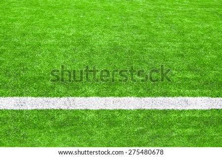 White stripe on the green soccer field. - stock photo