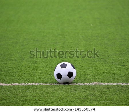 White stripe on the green soccer field with ball - stock photo