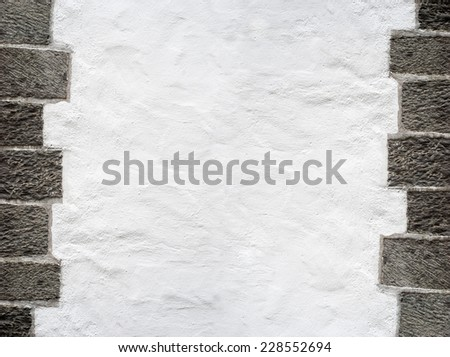 white stucco wall, big grey brick frame background - stock photo