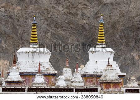 White stupa in Lamayuru Tibetan Buddhist monastery. Ladakh, India  - stock photo