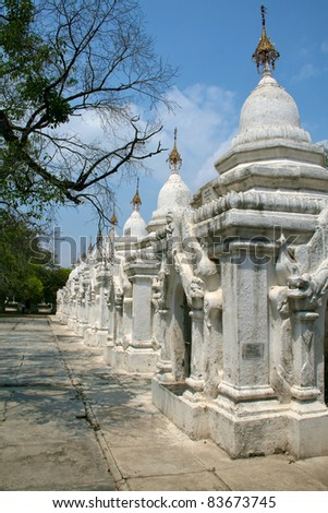 White stupas in Kuthodaw temple in Mandalay, Myanmar (Burma).