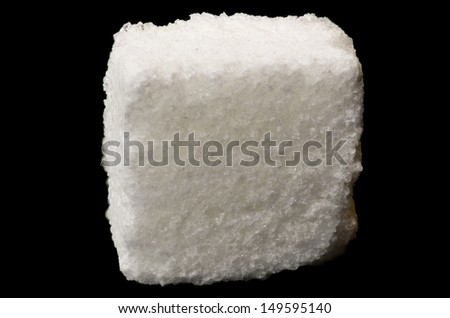 White sugar cube isolated on black background - stock photo