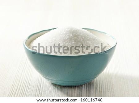 white sugar in a blue bowl - stock photo