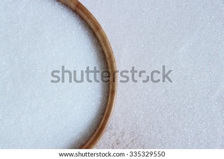 White sugar in wood bowl - stock photo