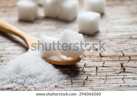 white sugar in wood spoon on wood table - stock photo