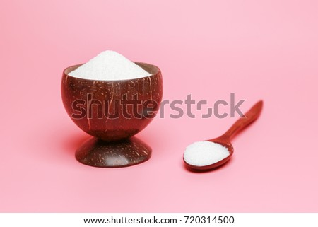 White sugar on a pink background