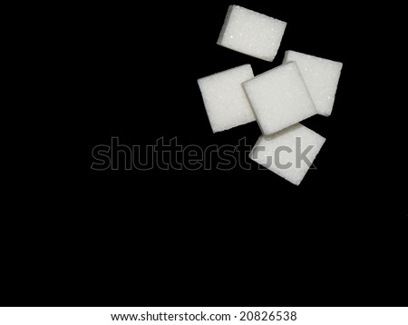 White sugar on black background - stock photo