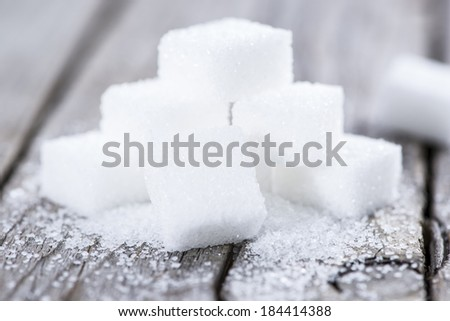 White Sugar on vintage wooden table (close-up image) - stock photo