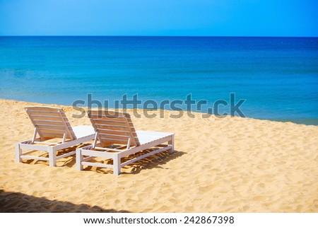 White sunbeds on wild sea beach in Phu Quoc island Vietnam - stock photo