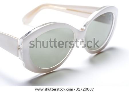 White Sunglasses on a White Background - stock photo