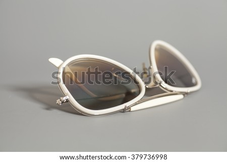 White Sunglasses on gray background