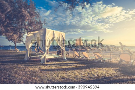 White sunlounger on greek coastline at sunrise