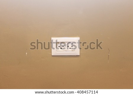 White switch on a brown wall - stock photo