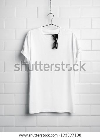 White t-shirt and black sunglasses - stock photo