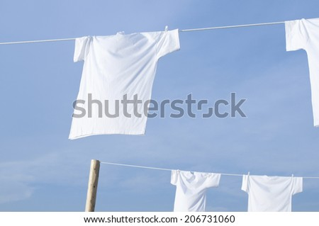 White T-Shirt And Blue Sky