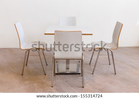 White table and chair set - stock photo