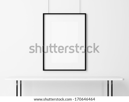 White table and empty picture frame - stock photo