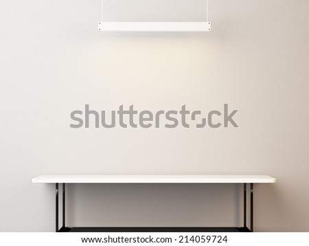 White table and lamp - stock photo