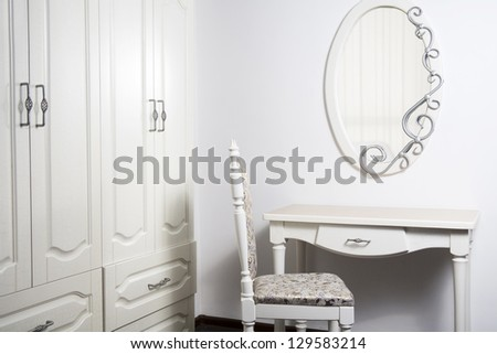 White Table, chair, mirror in ancient, modernist style - stock photo