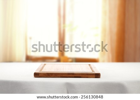 white tablecloth and desk of wood  - stock photo