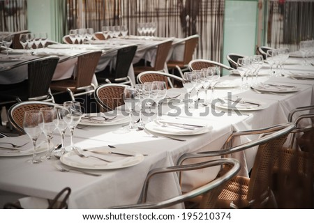 white tablecloth and empty glasses in restaurant - stock photo