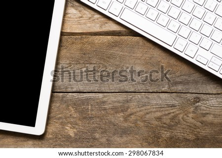 White Tablet. Tablet pc on wooden table - stock photo