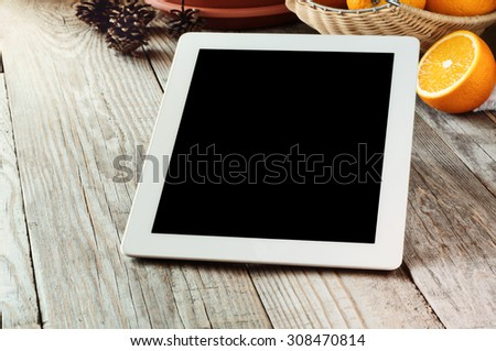white tablet with blank screen on wooden desk close-up. Copy space. Free space for text - stock photo