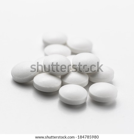 white Tablets drugs pills therapy doctor flu antibiotic pharmacy medicine medical - stock photo