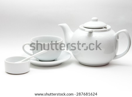 white tableware, large kettle, Cup, bowl, porcelain spoon on a gray gradient background - stock photo