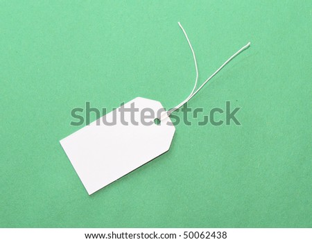 White tag on green