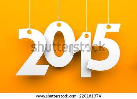 White tags with 2015 on orange background - stock photo