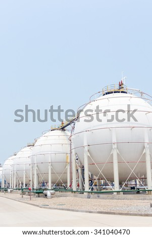 white tanks in oil depot in clear sky - stock photo