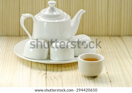 White tea pot with tea cups set
