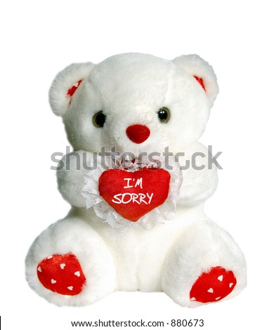 "White teddy bear holding heart pillow that says ""I'm Sorry"""