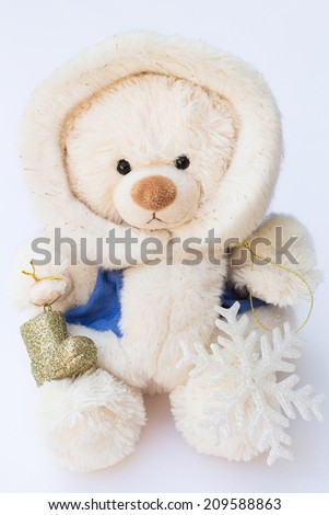 White Teddy Bear in a Winter Coat and Two Christmas Tree Ornaments