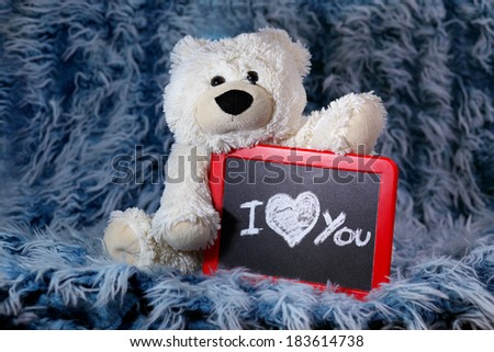 White teddy bear with table - stock photo