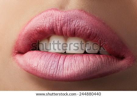 White teeth and beautiful fashion matte pink lips - stock photo