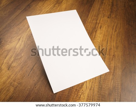 White template paper on wood texture - stock photo