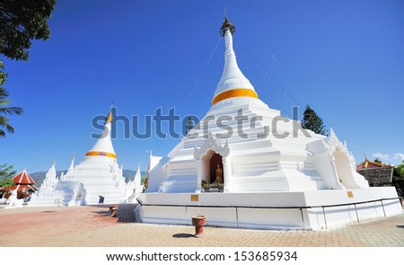 White temple and pagoda a religion of Thailand name Wat doikongmu at Mae Hong Son province north of Thailand - stock photo