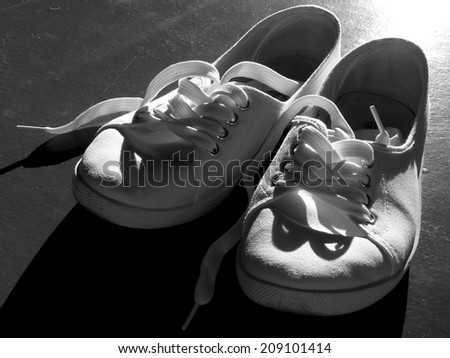 white tennis shoes in black and white - stock photo