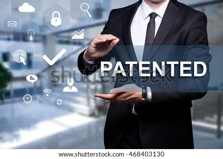 "White text with icon ""Patented"" in the hands of a businessman. Business concept. Internet concept."