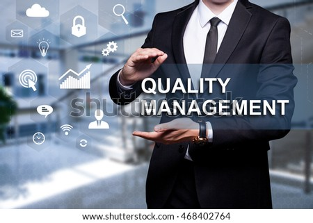 "White text with icon ""Quality Management"" in the hands of a businessman. Business concept. Internet concept."