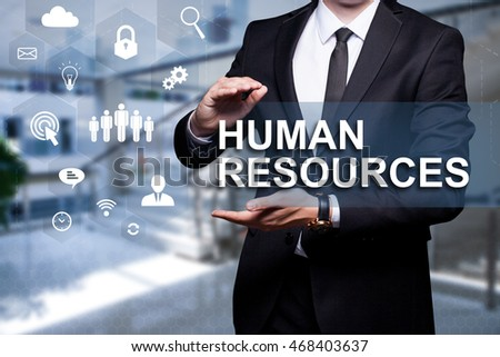 "White text with icons ""Human Resources"" in the hands of a businessman. Business concept. Internet concept."